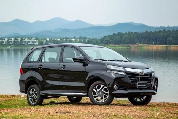 A picture of the Toyota Avanza parked beside a lake.