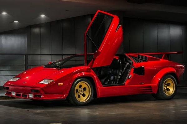 A Lamborghini Countach with it's driver's side door open