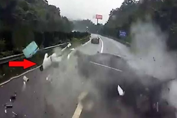 A picture of a passenger being thrown out of his car due to a crash.