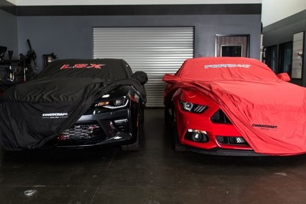 muscle cars in car cover