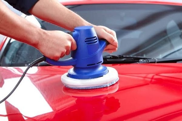 wax and buffing red car