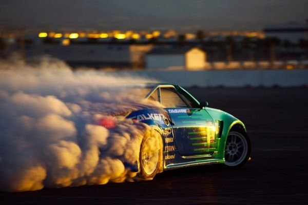 A Nissan 350Z mid drift, producing a lot of tire smoke