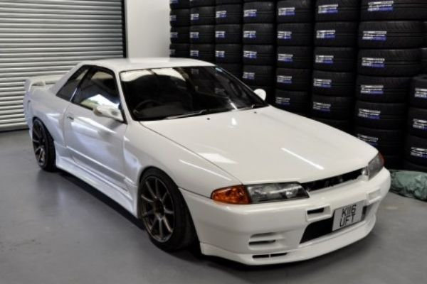 A picture of a Nissan R32 GTST in a dealership