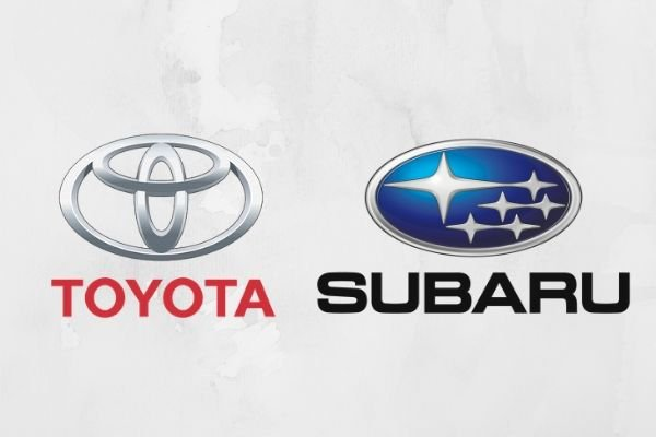 A picture of the Toyota logo and Subaru logo side by side
