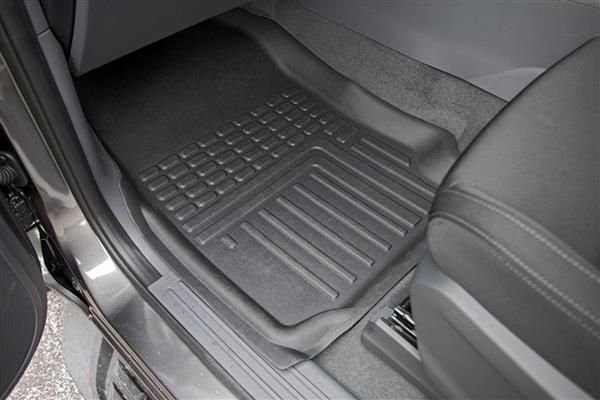 A picture of a deep dish floormat inside a car