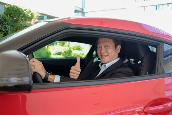 A picture of President Okamoto aboard the Toyota GR Supra