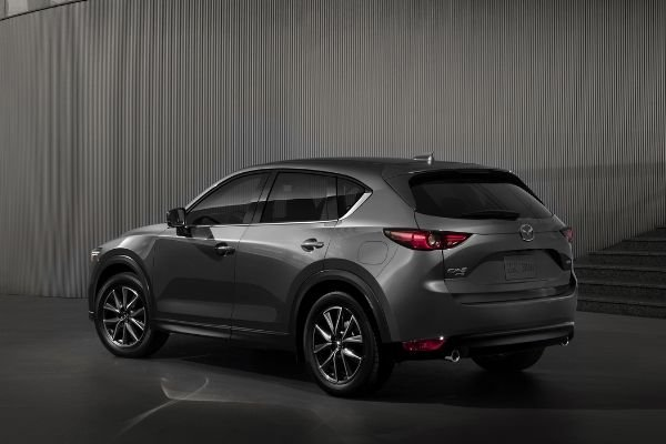 A shot of the rear of the CX-8 in a 3d generated enviroment