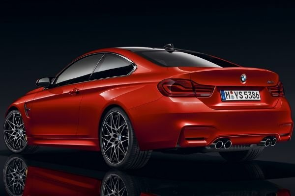 A picture of the rear quarter panel of a red M4 Coupe
