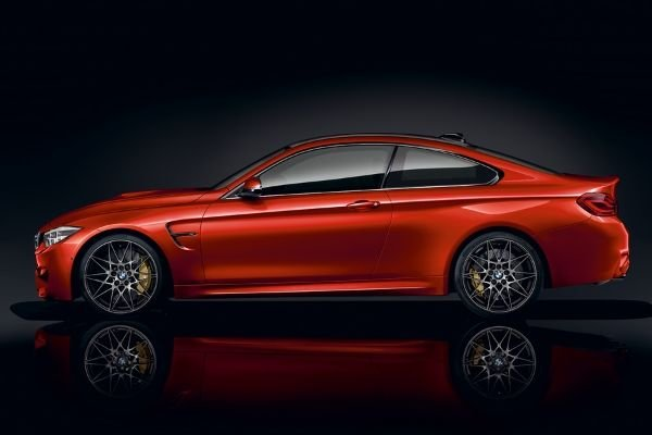 A picture of a red M4 Coupe with a dark background