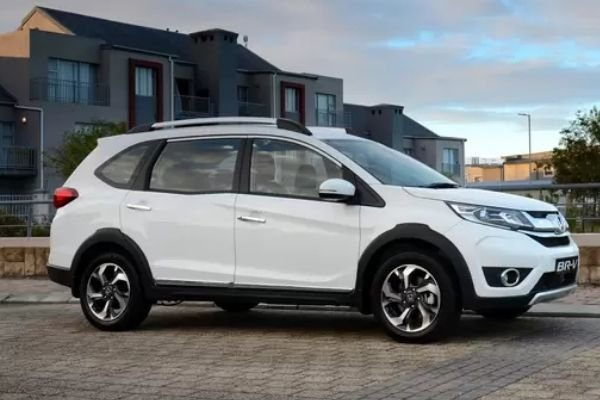 A picture of a white Honda BR-V parked in the suburbs
