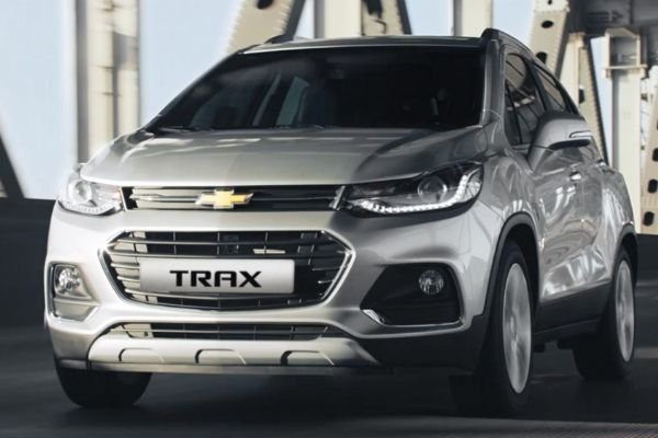 A picture of the Chevy Trax on a city road