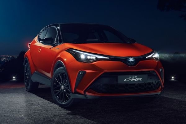 A picture of an orange Toyota C-HR in the dark