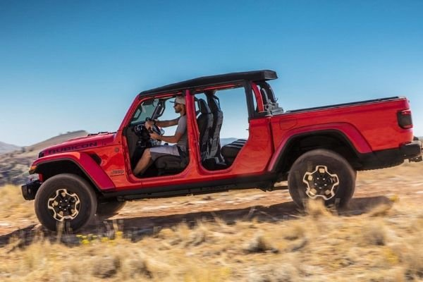 A picture of the Jeep Gladiator travelling fast over a hill