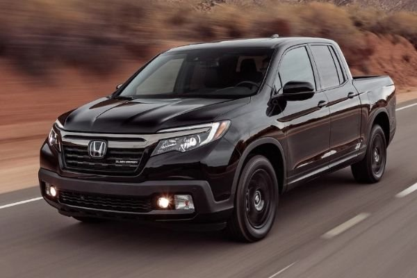 The Ridgeline travelling fast on a mountain road