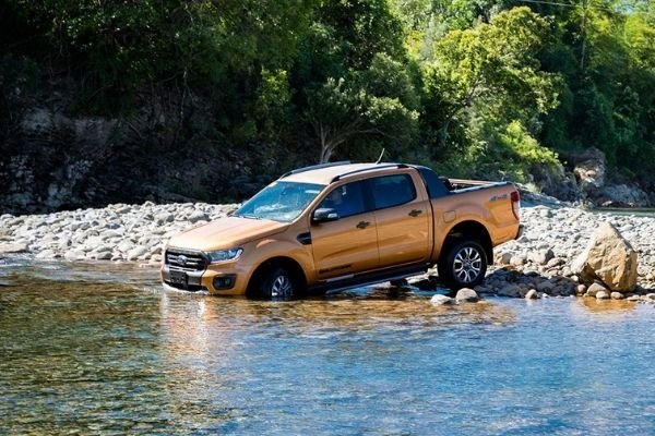 A picture of the Ford Ranger about to take a dip in the river