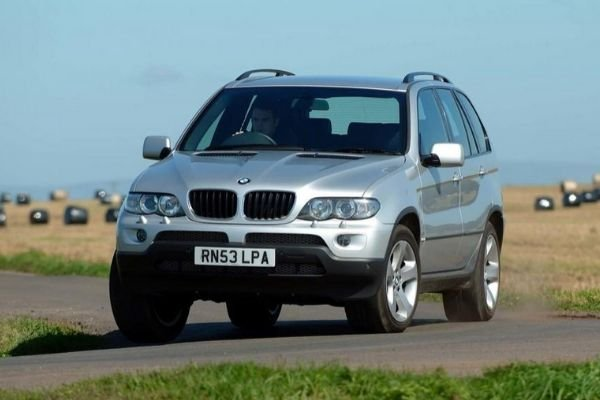 A picture of the first generation BMW X5 on the road