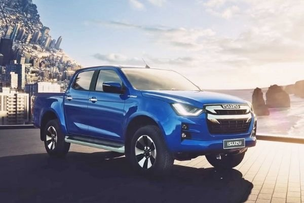 A picture of the Isuzu D-Max under the sun with a twisted city-scape as a background