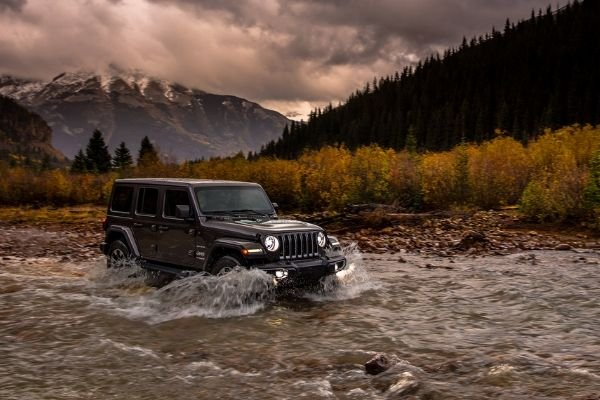 The Jeep Wrangler driving in the water
