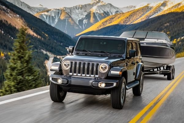 The 2020 Jeep Wrangler driving on a hill