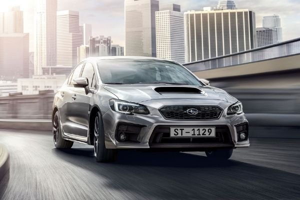 A picture of a silver WRX in the city
