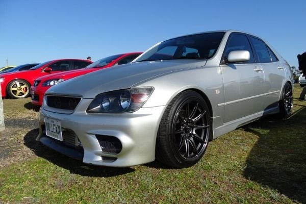 A picture of a Lexus IS200 in a car meet