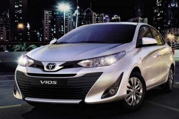 A picture of a Vios in the city at night
