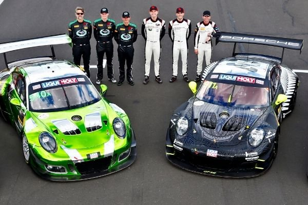 A picture of several Porsche race drivers
