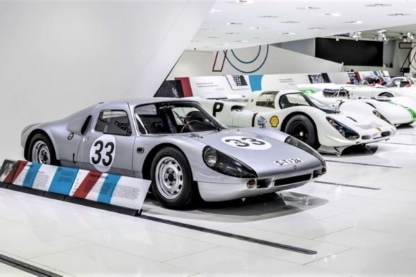 A picture of several cars in the Porsche museum