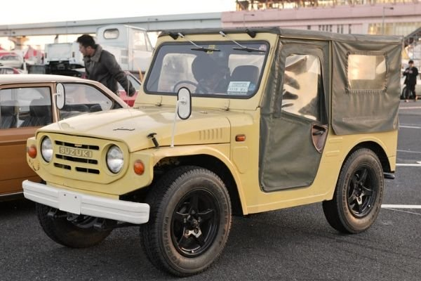 A picture of a 1st gen Jimny parked in a car show