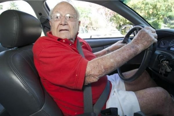 A picture of an old man about to drive