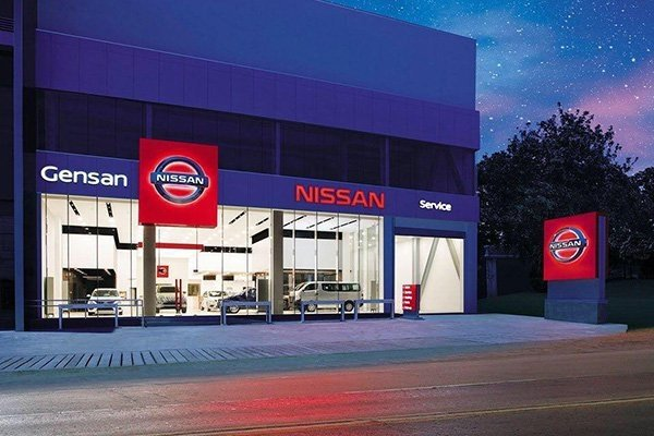 A Nissan dealership at night