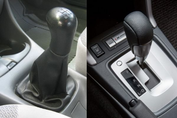 A picture of a manual and an automatic transmission side by side