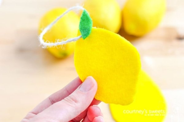 A felt lemon car freshener