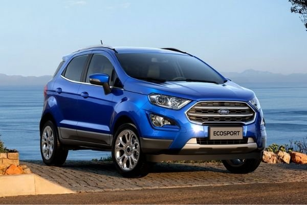 A picture of a blue EcoSport near a cliff