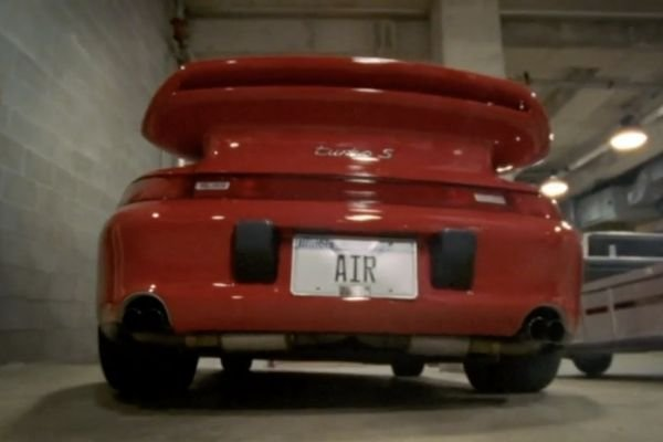 A picture of the rear of MJ's red 911 Turbo S