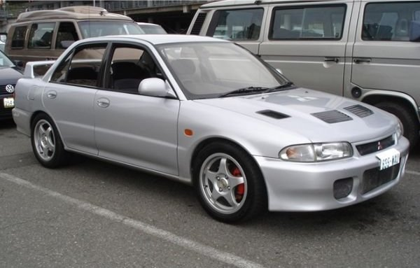 A picture of the first ever Lancer EVO i on a parking lot