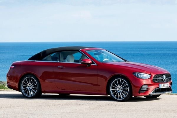 A picture of the E-Class convertible near the ocean