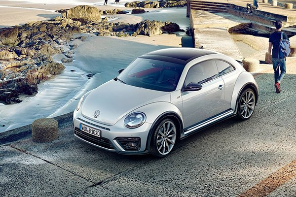 A picture of the discontinued new Beetle parked