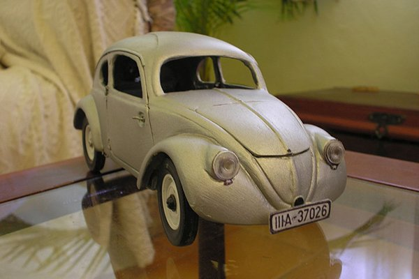 A picture of a sculpture of the Beetle Type 1 in a museum