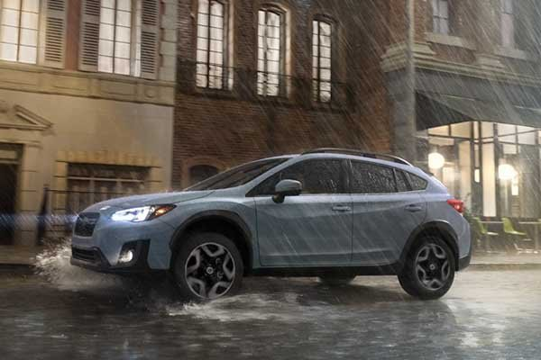 A picture of the Subaru XV on a rainy road