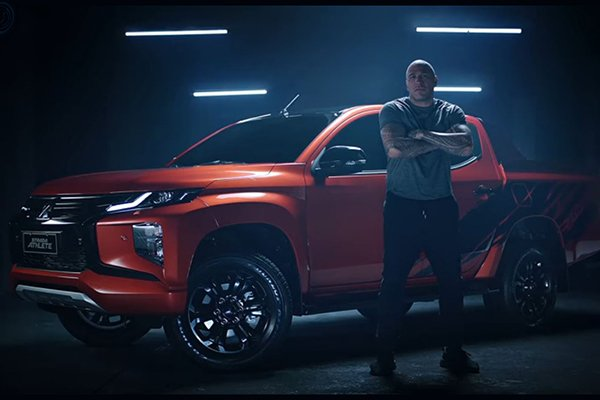 Brandon Vera standing near the Mitsubishi Strada Athlete