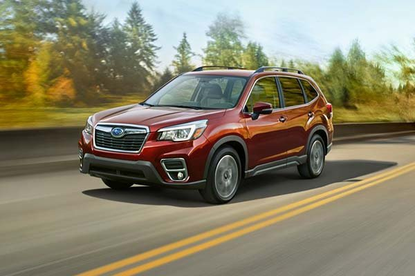 A red Forester on the road
