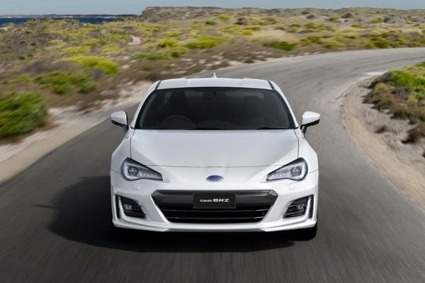 A white BRZ on the road