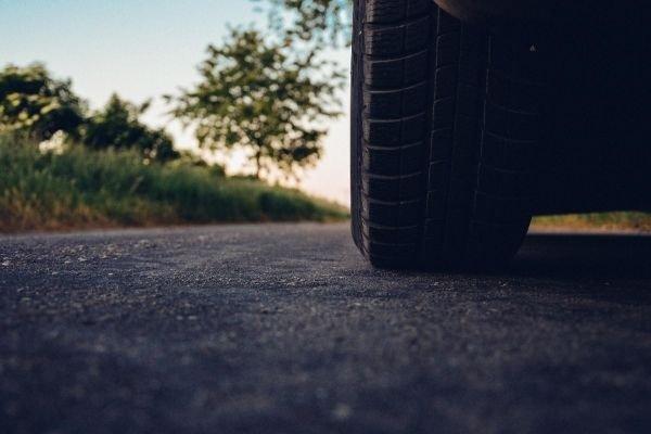 A tire of a car under a sunset