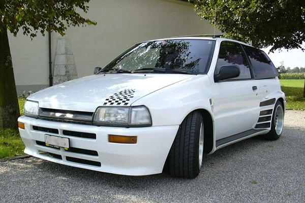 A picture of a heavily modded Daihatsu Charade.