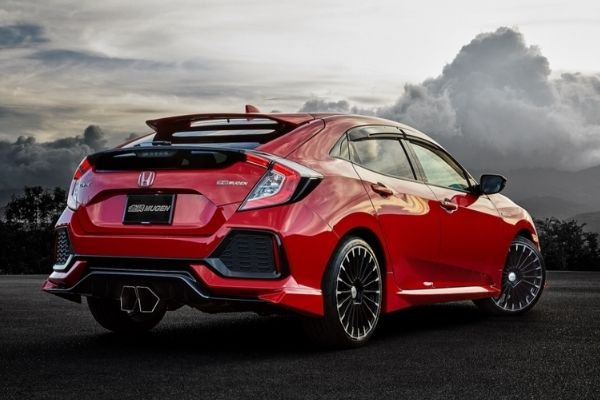 A red Civic Hatchback showing its rear end