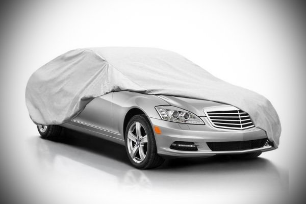 A picture of a Mercedes-Benz with a car cover.