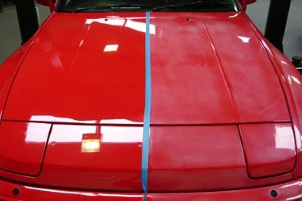 A red car getting painted