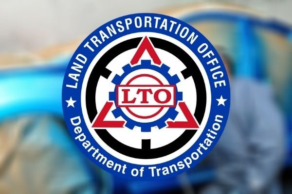 The LTO logo with a blurred man painting a car at the back