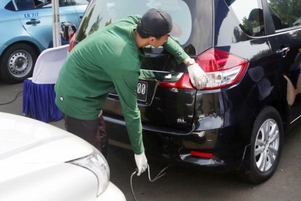 A technician performing emissions testing.